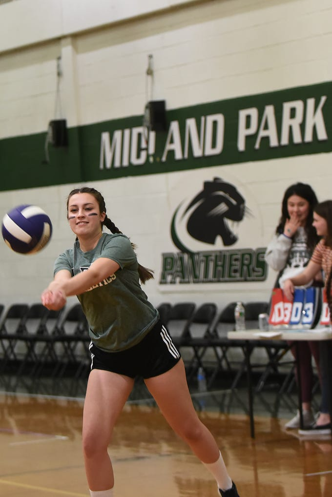 A Fundraising Volleyball Tournament is held at Midland Park High School in Midland Park on Saturday February 9, 2019. The event is to raise money for the families of two young people seriously injured in an auto accident in December. Helena Van Vleit, the Captain of 'Bump N Grind' hits the ball.