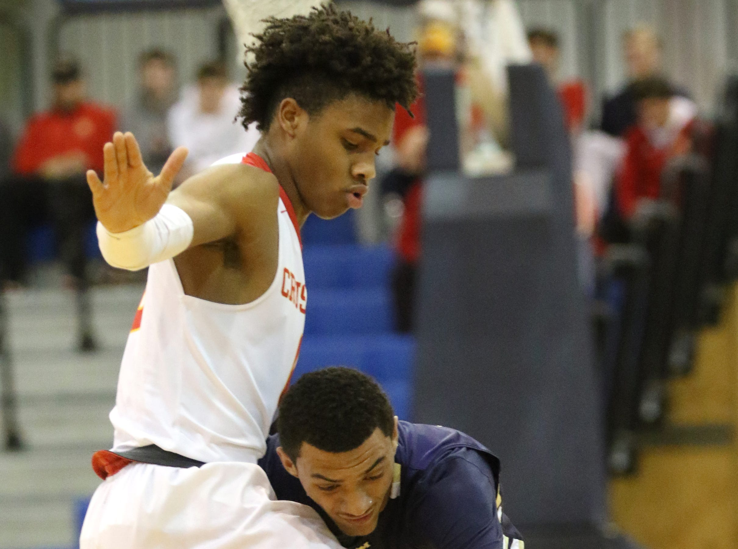 Jayson Earle, of Bergen Catholic, and Jaden Quinerly, of Ramsey, bump into each other as they try to get to the ball.  Sunday, February 10, 2019