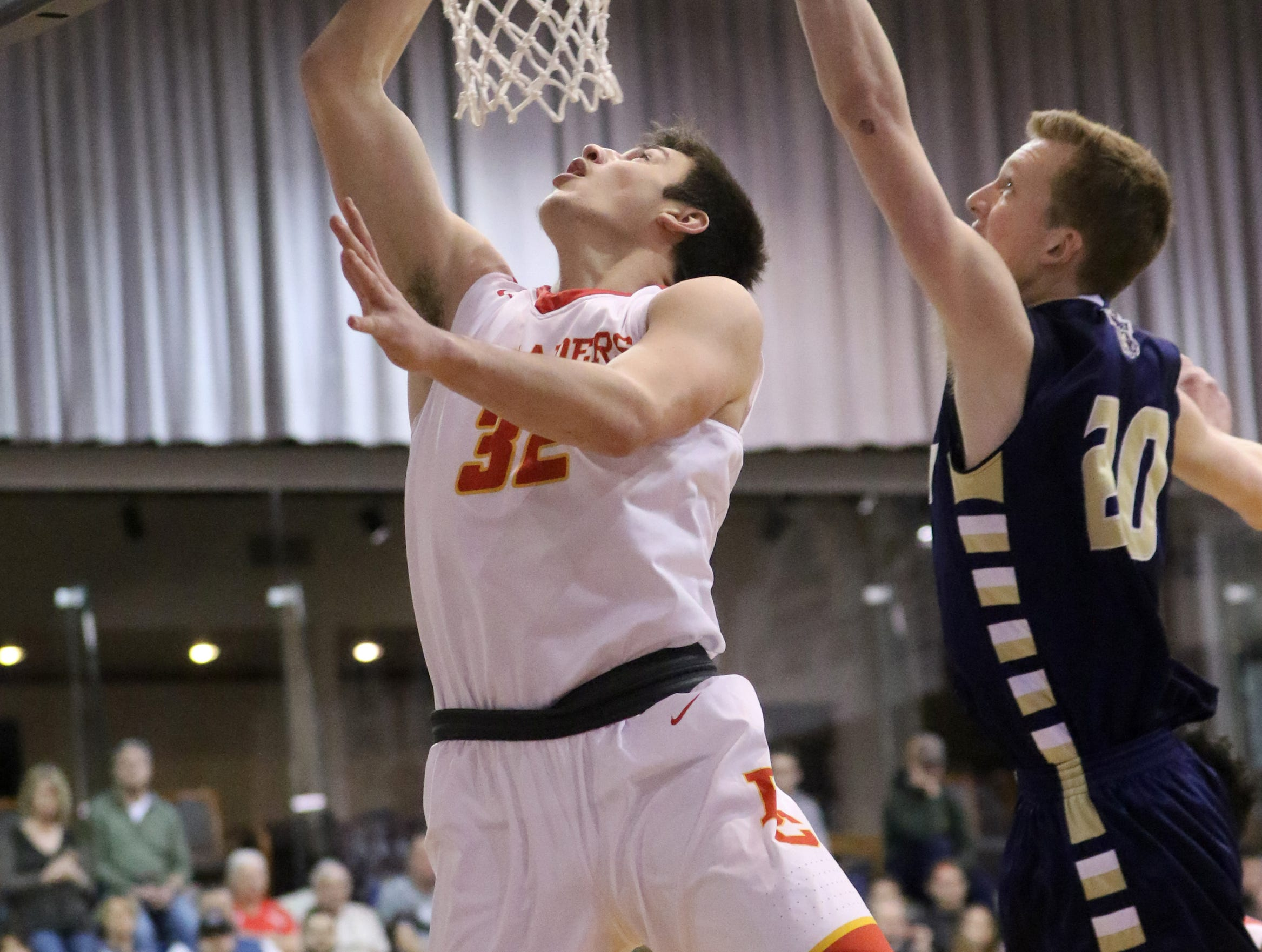 Zach Freemantle, of Bergen Catholic, goes for two against Sean Hansen, of Ramsey.  Sunday, February 10, 2019