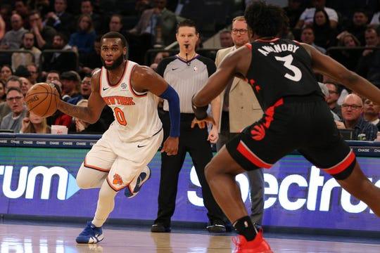 New York Knicks guard Kadeem Allen (0) controls the ball against Toronto Raptors forward OG Anunoby (3) during the fourth quarter at Madison Square Garden.