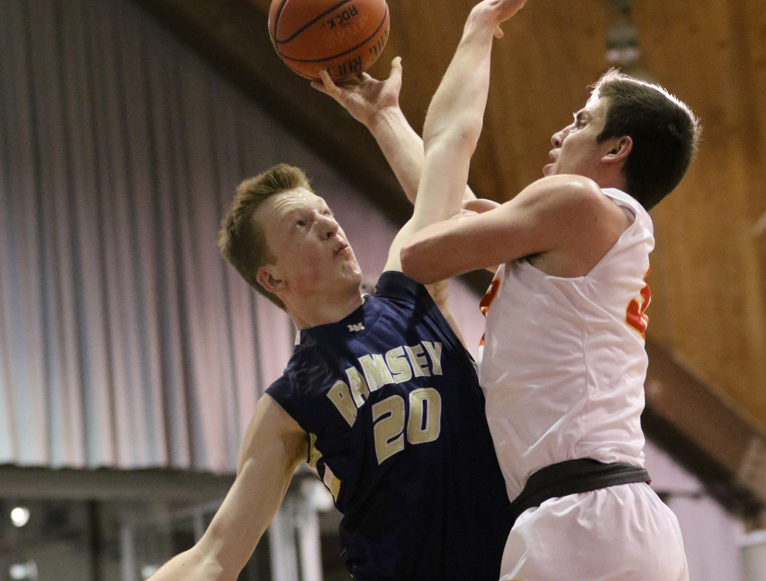 Sean Hansen, of Ramsey, tries to block Zach Freemantle, of Bergen Catholic.  The Crusaders went on to win, 60-50, at the Bergen County Jamboree.  Sunday, February 10, 2019