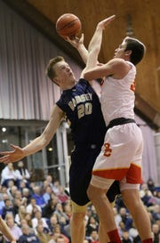 Sean Hansen (left) and Ramsey are the defending champions and No. 1 seed in the North 1, Group 2 sectional boys basketball tournament.