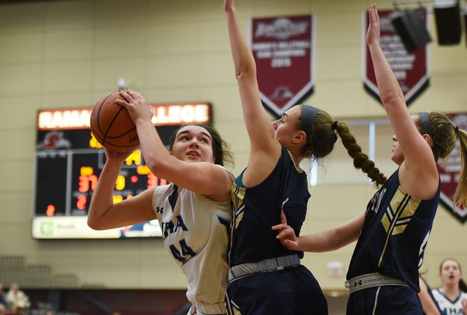 Emma Matesic (no.44) of Immaculate Heart looks for an opening against NV/Old Tappan defense in the second half during the 2019 Bergen County girls basketball championship semifinal at Ramapo College in Mahwah on 02/10/19.