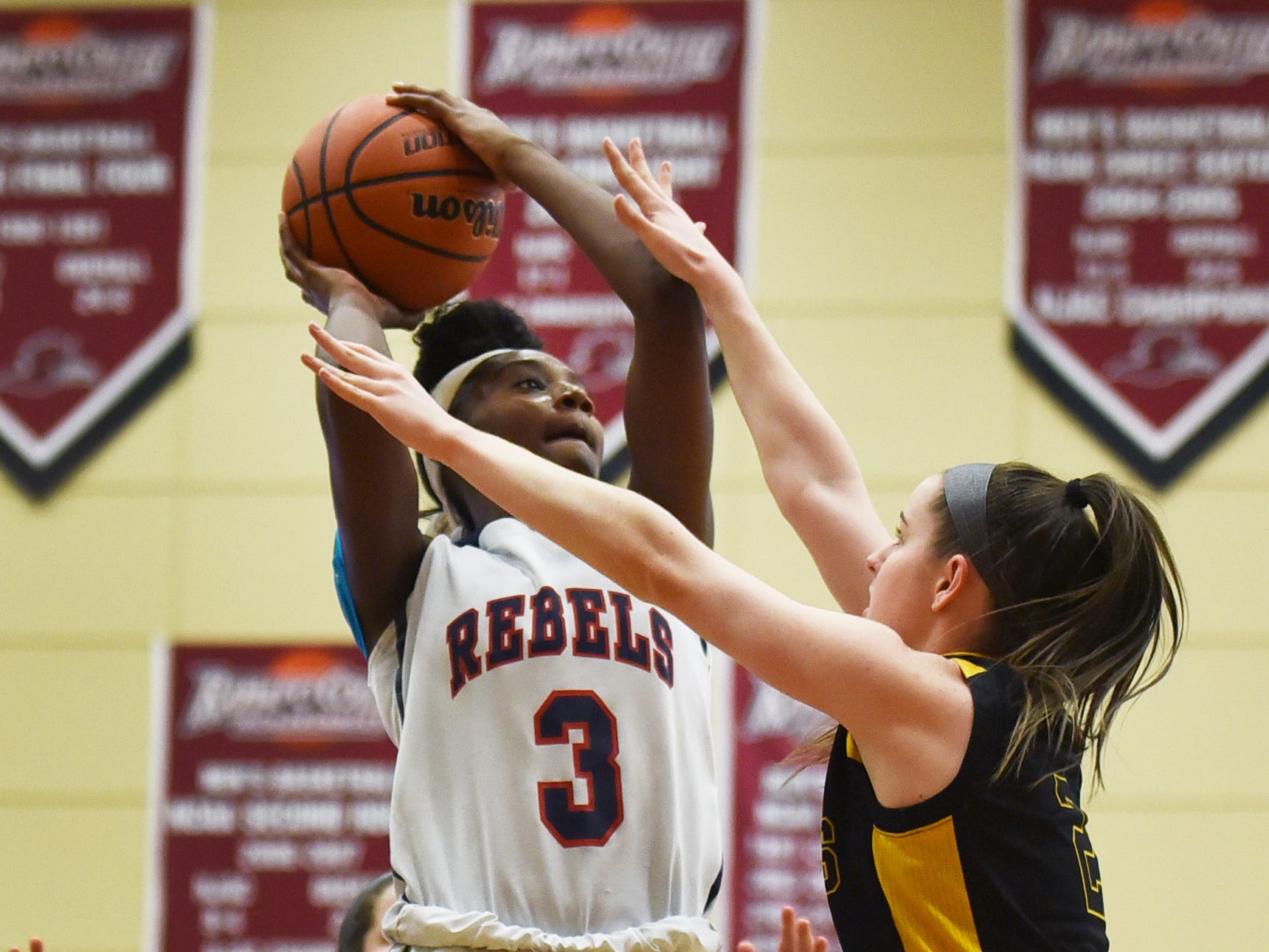Jaida Patrick (no.3) of Saddle River Day makes a shot over Caitlin Conlon (no.2) of Paramus Catholic in the first half during the 2019 Bergen County girls basketball championship semifinal at Ramapo College in Mahwah on 02/10/19.