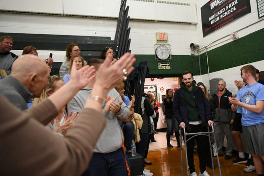 A fundraising Volleyball Tournament is held at Midland Park High School in Midland Park on Saturday February 9, 2019. The event is to raise money for the families of two young people seriously injured in an auto accident in December. Ryan Moore, who was injured in the accident, is greeted as he arrives at the gym.