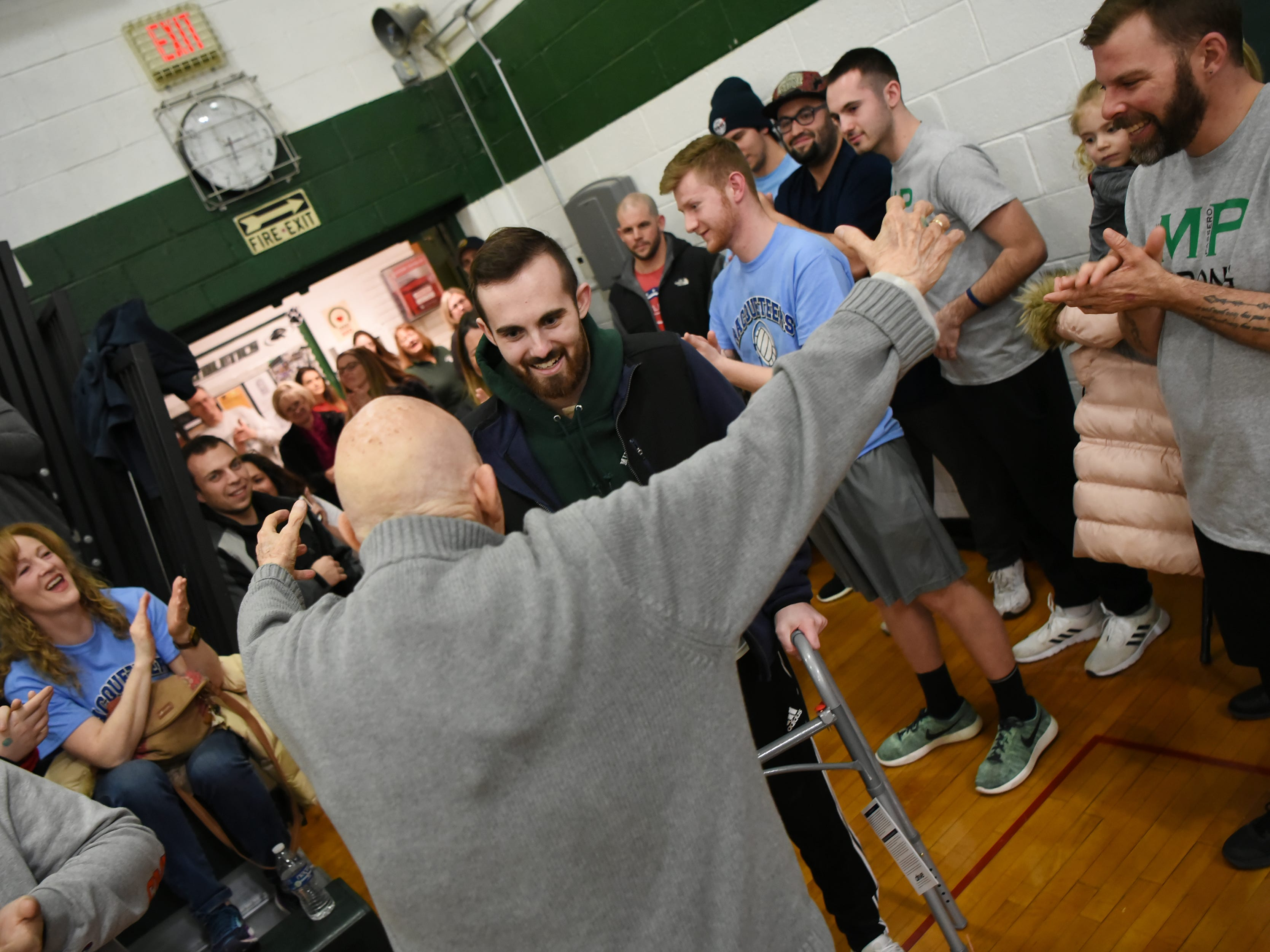 A fundraising Volleyball Tournament is held at Midland Park High School in Midland Park on Saturday February 9, 2019. The event is to raise money for the families of two young people seriously injured in an auto accident in December. Ryan Moore, who was injured in the accident, is greeted by his Grandfather, Donald Rick as he arrives at the gym.