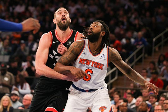Toronto Raptors center Marc Gasol (33) fights for position on a free throw against New York Knicks center DeAndre Jordan (6) during the second quarter at Madison Square Garden.