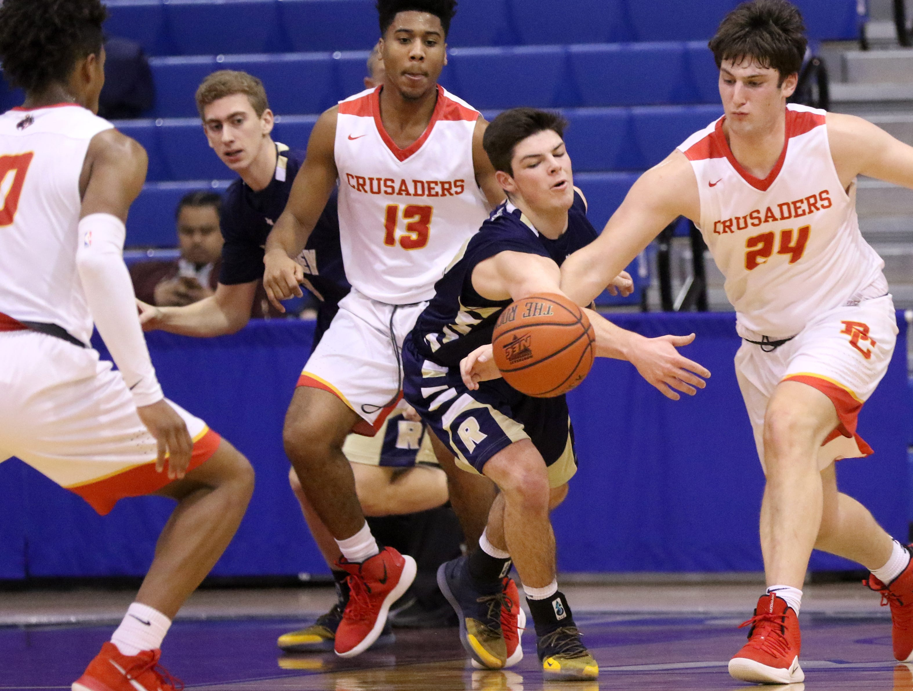 Brooks Thompson, of Ramsey and Matt Zona, of Bergen Catholic, battle for the ball during the Bergen County Jamboree. Sunday, February 10, 2019
