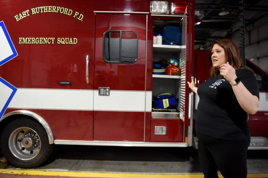 "Lt. Alexis Harden of the East Rutherford EMS squad, shows the spot on the ambulance where their new ""Lucas,"" a mechanical chest compression machine will be housed for easy access when they arrive at calls. The EMS squad received the machine on Sunday, February 10, 2019 at the Grove St. Firehouse."