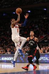 New York Knicks guard Kadeem Allen (0) shoots against Toronto Raptors guard Danny Green (14) during the fourth quarter at Madison Square Garden.