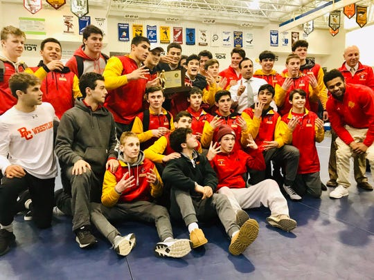 Bergen Catholic poses with the trophy after beating St. Augustine for its eighth straight state title on Feb. 10, 2019.