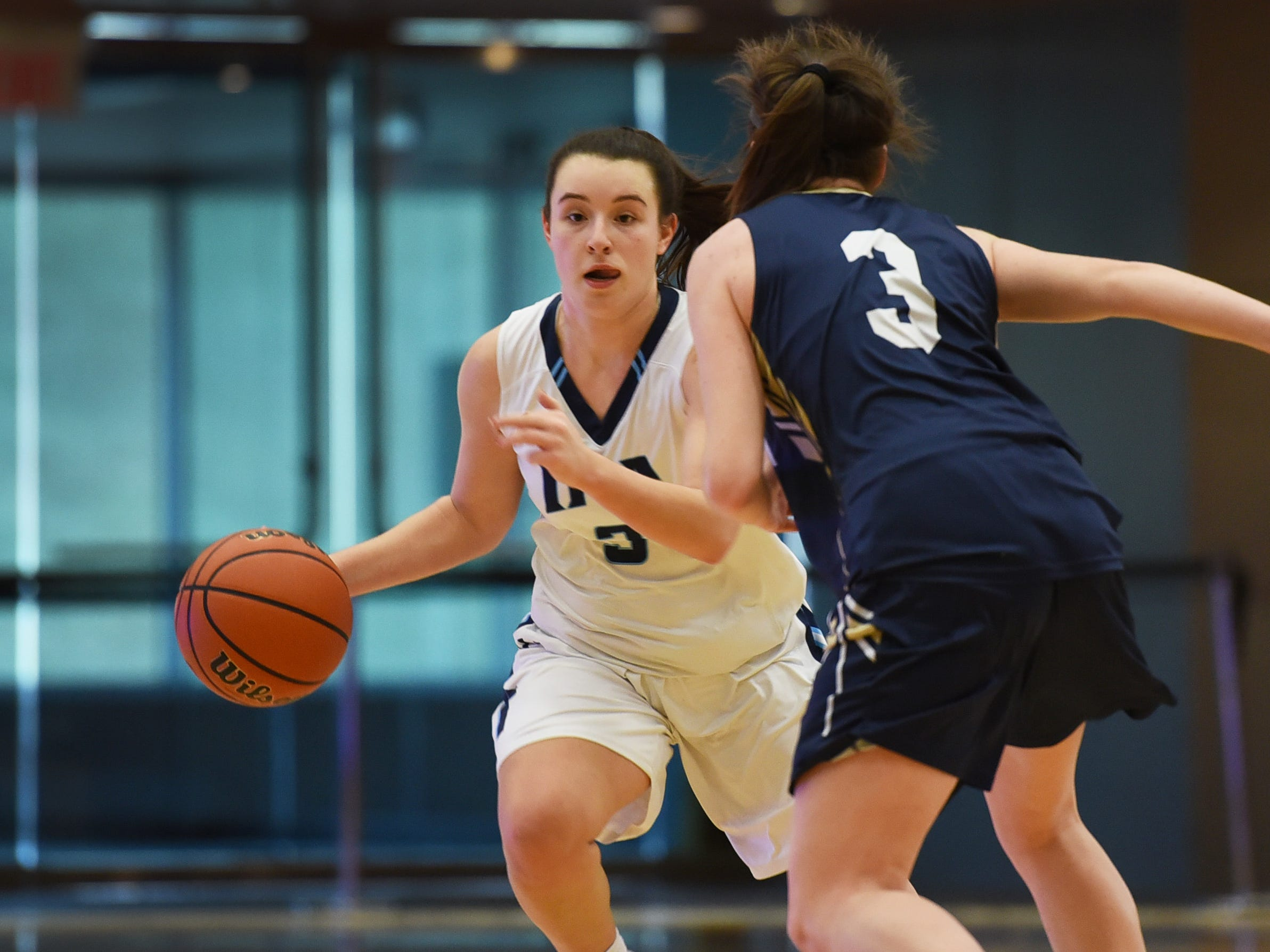 Brittany Graff (no. 3) of Immaculate Heart makes her way with the ball as she tries to pass Noelle Gonzalez (no. 3) of NV/Old Tappan in the first half during the 2019 Bergen County girls basketball championship semifinal at Ramapo College in Mahwah on 02/10/19.