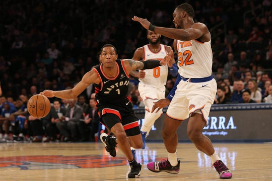 Toronto Raptors guard Patrick McCaw (1) controls the ball against New York Knicks forward Noah Vonleh (32) during the second quarter at Madison Square Garden.