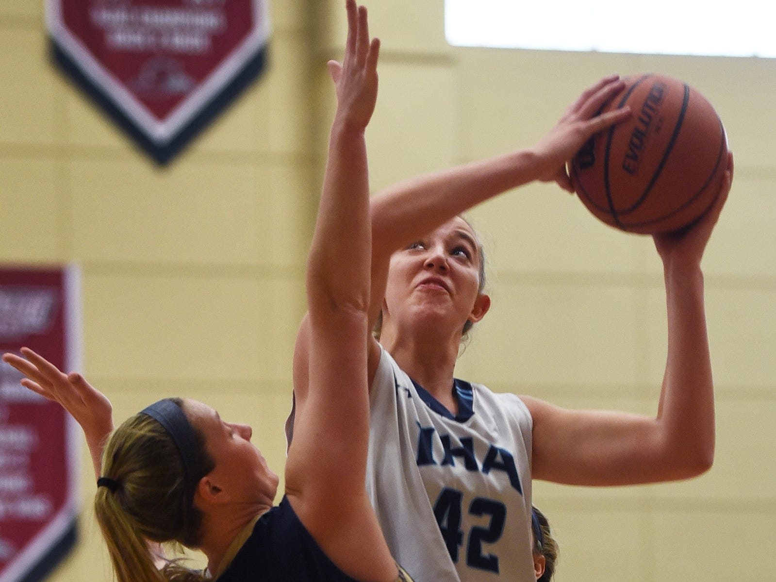 Anna Morris (no. 42) of Immaculate Heart tries to shoot over Megan Weis (no. 11)  of NV/Old Tappan in the first half during the 2019 Bergen County girls basketball championship semifinal at Ramapo College in Mahwah on 02/10/19.