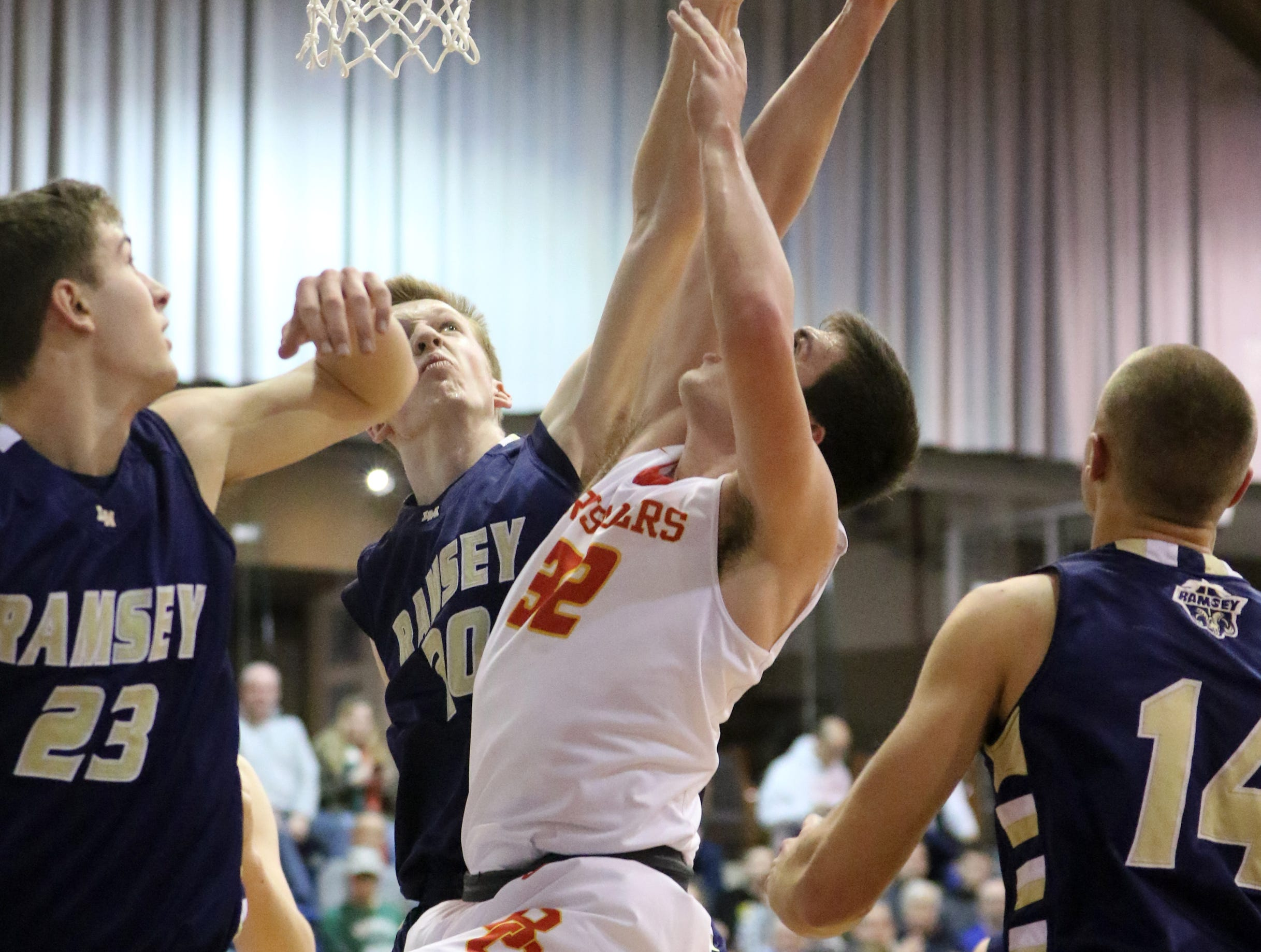 Sean Hansen, of Ramsey, blocks Zach Freemantle, of Bergen Catholic, by the net.  Despite the block, the Crusaders went on to win, 60-50, at the Bergen County Jamboree.  Sunday, February 10, 2019