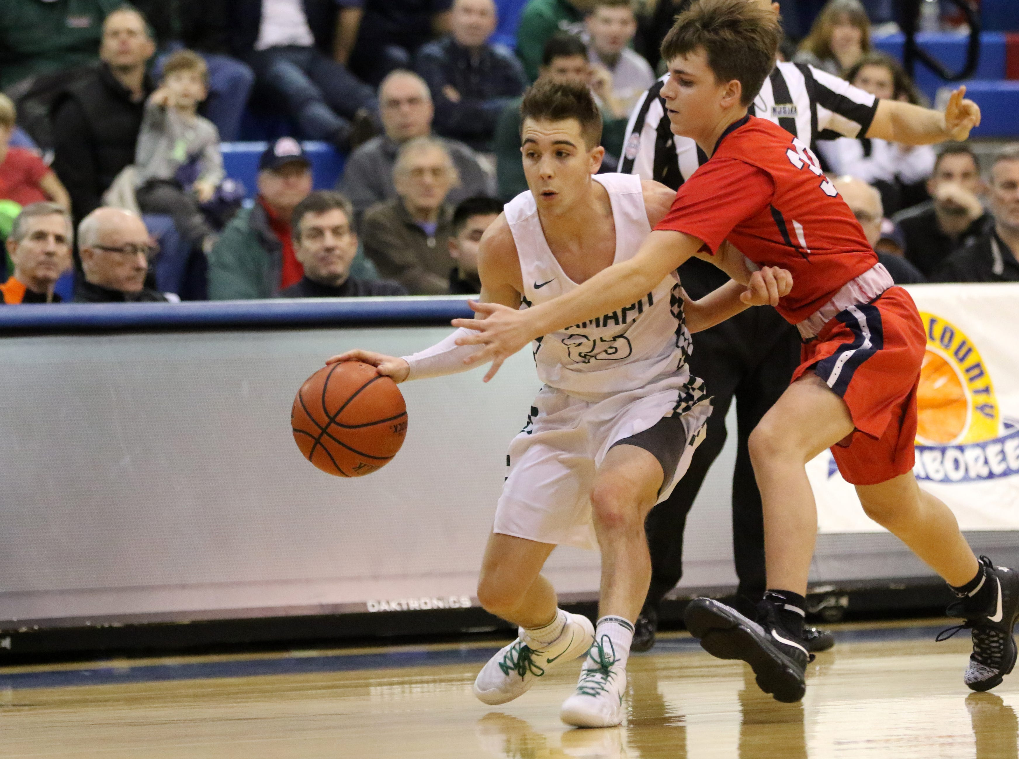 Kyle Hroncich, of Ramapo, tries to keep the ball away from Ryan Cassels, of Saddle River Day.  The Raiders won the Bergen County Jamboree game, 78-60. Sunday, February 10, 2019