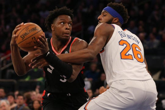 Feb 9, 2019; New York, NY, USA; Toronto Raptors forward OG Anunoby (3) drives against New York Knicks center Mitchell Robinson (26) during the second quarter at Madison Square Garden.