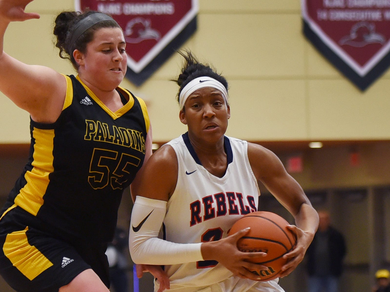 Sydnei Caldwell (no.21) of Saddle River Day makes her way past Julianna Kascic (no.55) of Paramus Catholic in the first half during the 2019 Bergen County girls basketball championship semifinal at Ramapo College in Mahwah on 02/10/19.