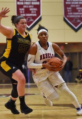 Paramus Catholic's Julianna Kascic (55) and Saddle River Day's Sydnei Caldwell (21) squared off in the 2019 Bergen County girls basketball championship semifinals at Ramapo College on Feb. 10, 2019.