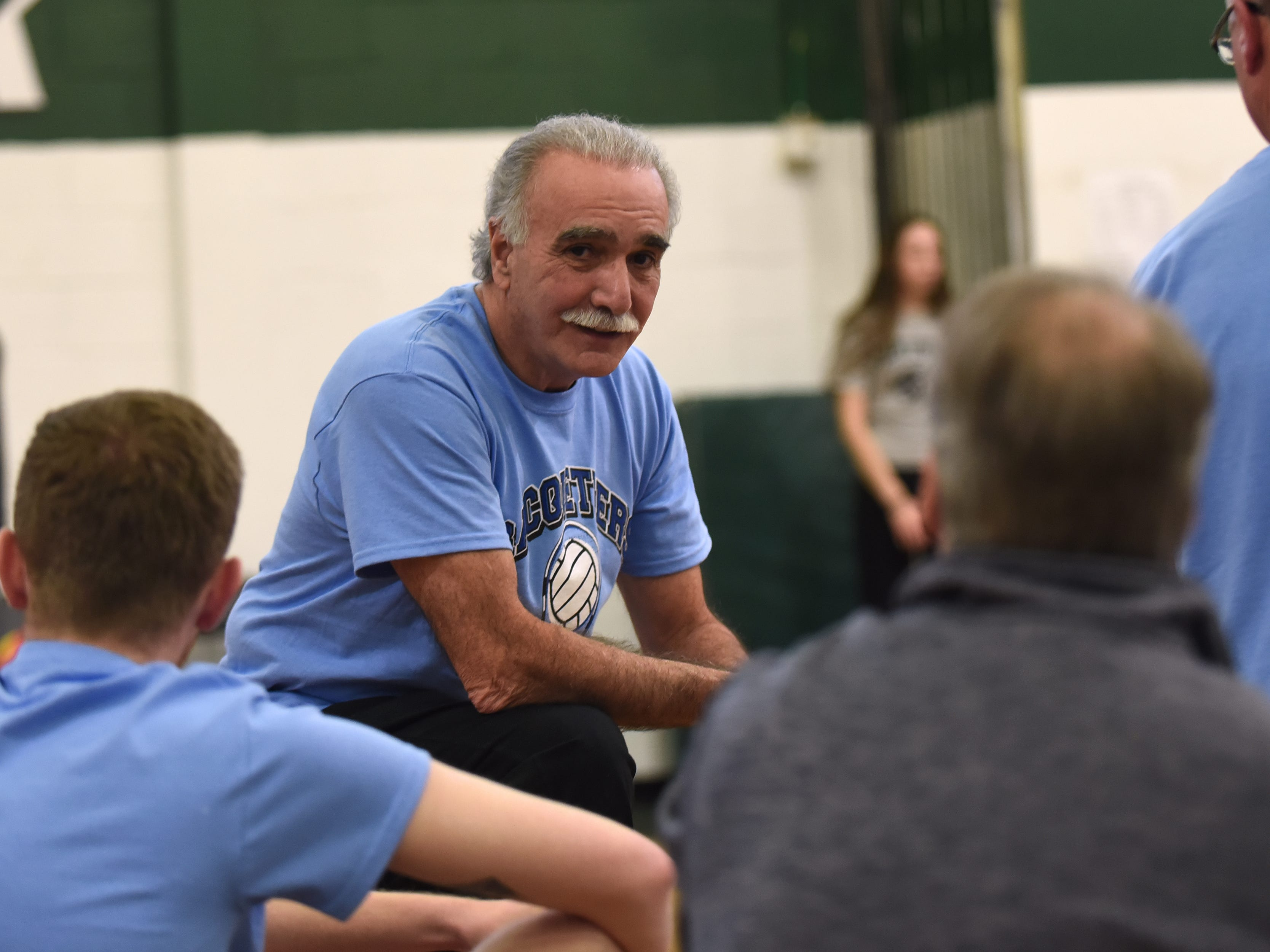 A Fundraising Volleyball Tournament is held at Midland Park High School in Midland Park on Saturday February 9, 2019. The event is to raise money for the families of two young people seriously injured in an auto accident in December. John Passero (center) and his team the Racqueteers get ready to play. Passero's daughter Jenna was one of the ones injured in the accident.
