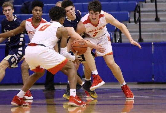 Brooks Thompson, of Ramsey and Matt Zona, of Bergen Catholic, battle for the ball as Jayson Earle (0), of Bergen Catholic looks to recover it, during the Bergen County Jamboree. Sunday, February 10, 2019