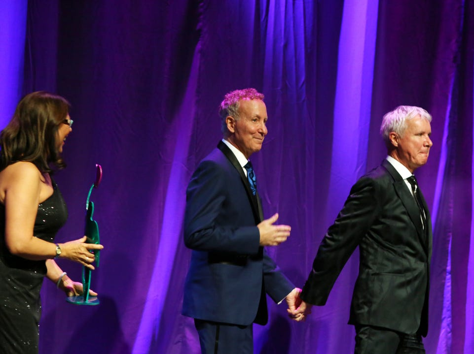 02/09/19 Taya Gray, Special to The Desert SunPartners For Life Award recipients James Williamson, right, and Geoff Kors enter the stage during the 25th Annual Steve Chase Humanitarian Awards at the Palm Springs Convention Center on Saturday, February 9, 2019.
