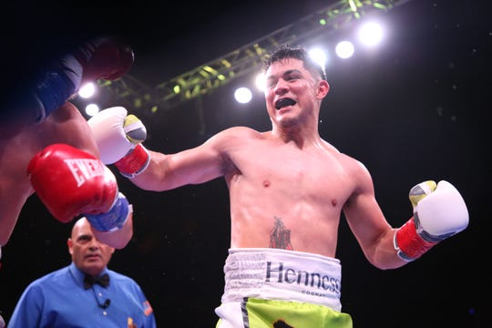 Joseph Diaz Jr. 27.1 (14kos) in green trunks lands a shot on Charles Huerta 20-5 (12kos) during their fight featherweight class at Fantasy Springs Casino.