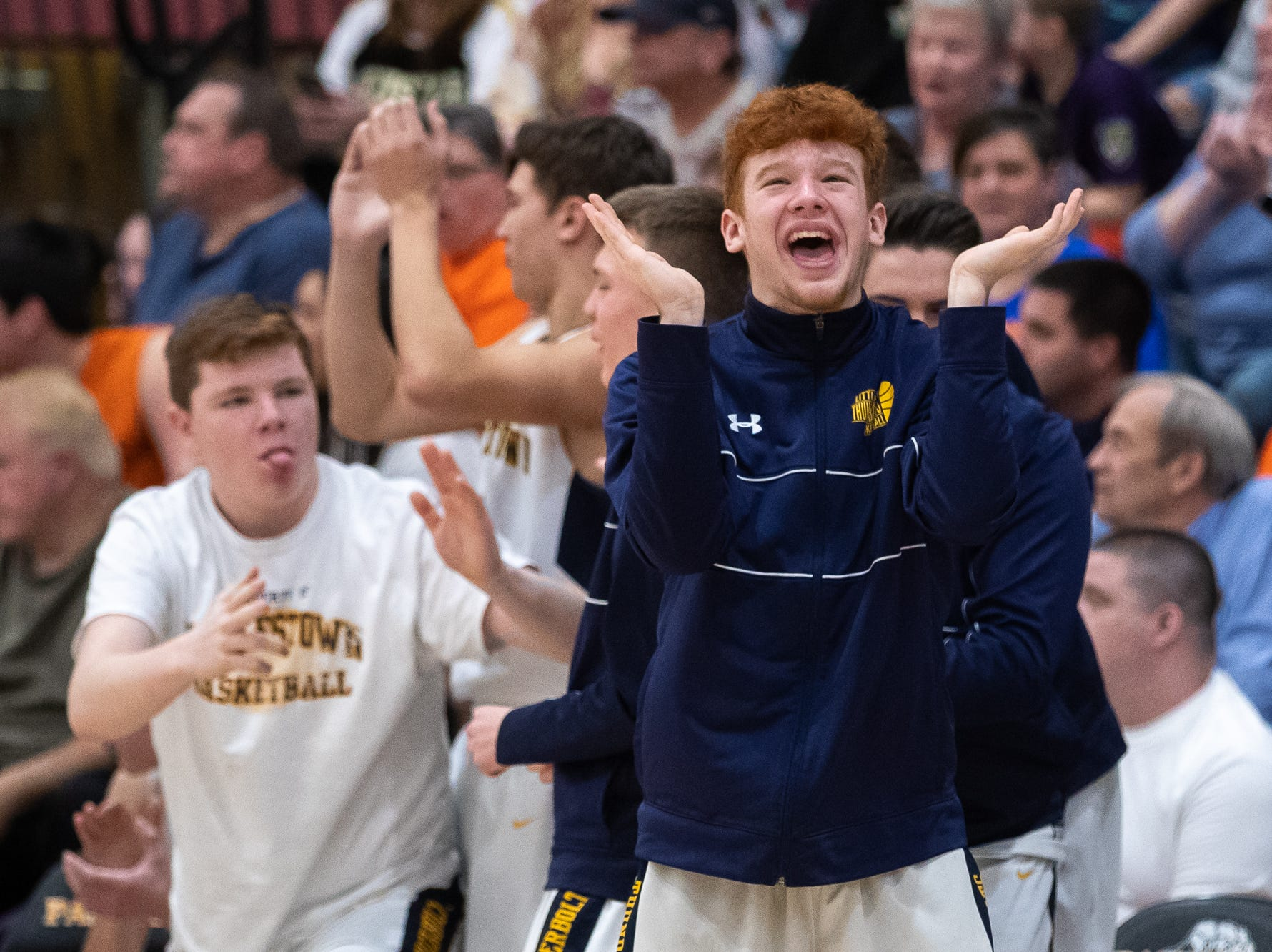 The Littlestown bench reacts to one of their teammates scoring during the second half of the YAIAA boys' basketball quarterfinals between Littlestown and West York, Saturday, Feb. 9, 2019, at Central York High School. The Littlestown Bolts defeated the West York Bulldogs 73-63.