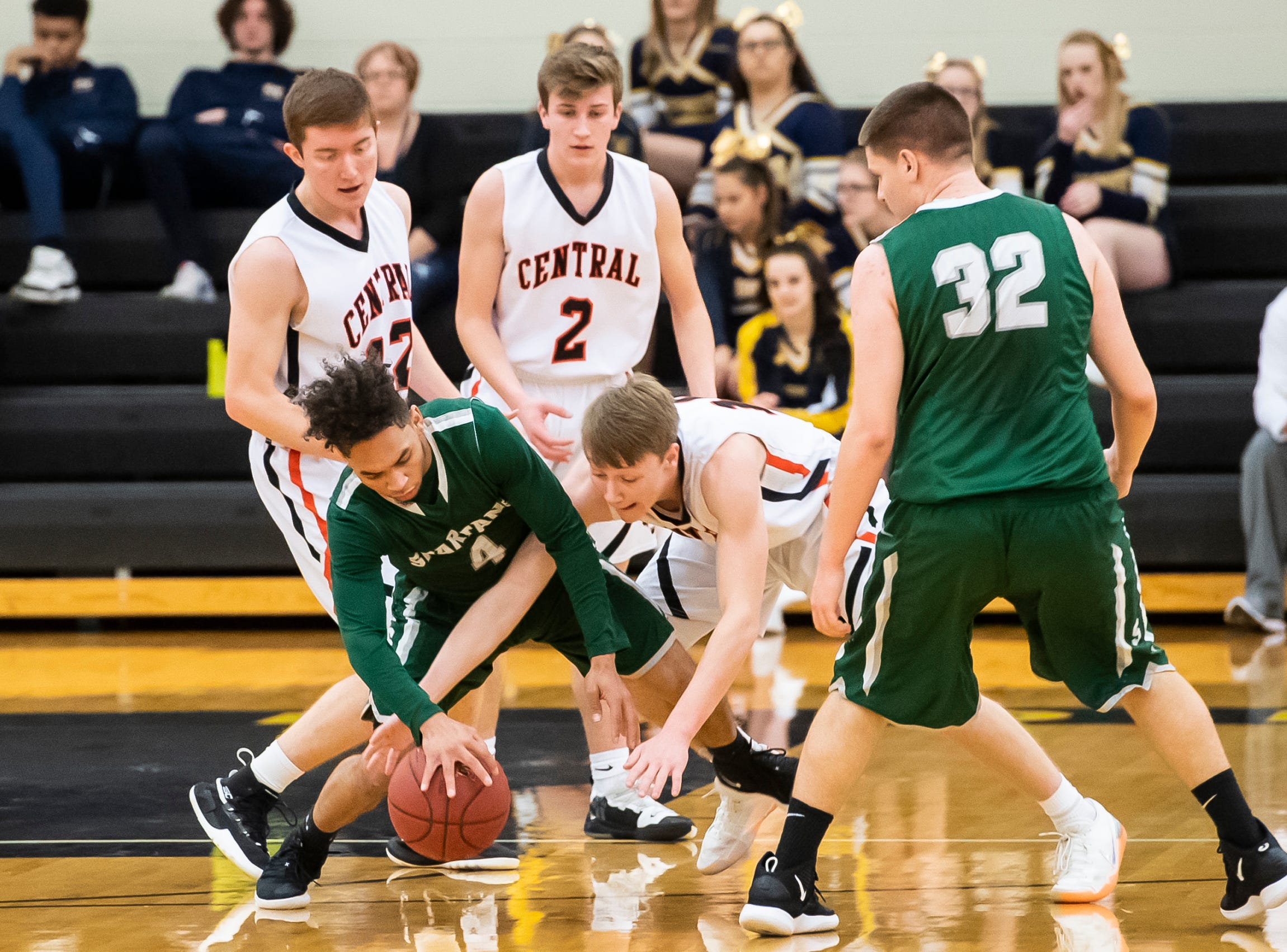 """Central York's Evan Eisenhart and York County Tech's Terence Romey reach for a loose ball during a YAIAA quarterfinal game at Red Lion High School Saturday, February 9, 2019. The Panthers won 74-43. The Panthers limited Romey to 10 points. """"(Romey)'s quick,"""" Central York head coach Kevin Schieler said. """"He's a very, very good scorer, and one of our things was to keep him in front of us."""""""