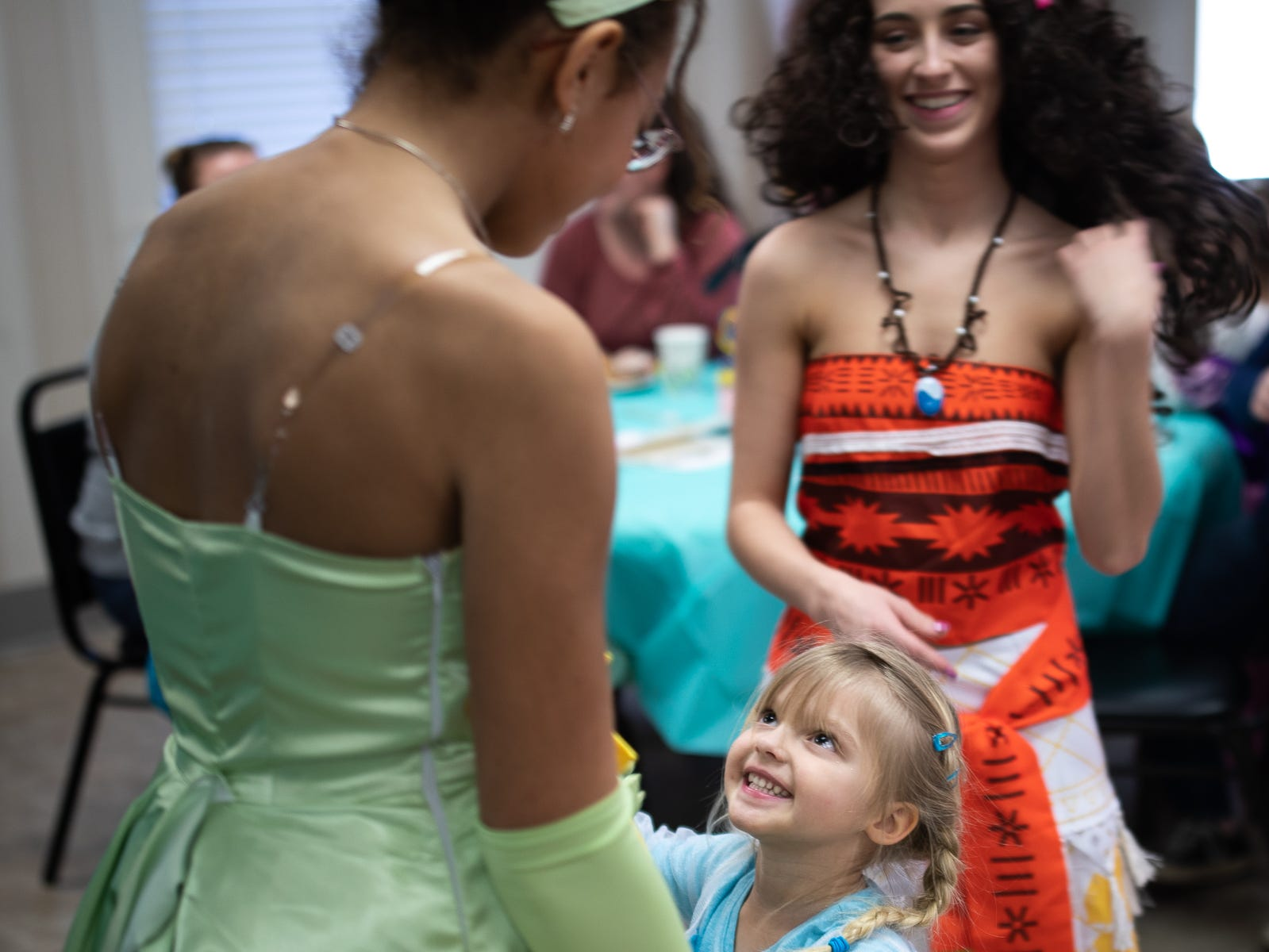 Princess Tiana dances with kids during a princess teatime hosted by the Black Rose Rollers, Saturday, Feb. 9, 2019, at the Hanover YWCA.