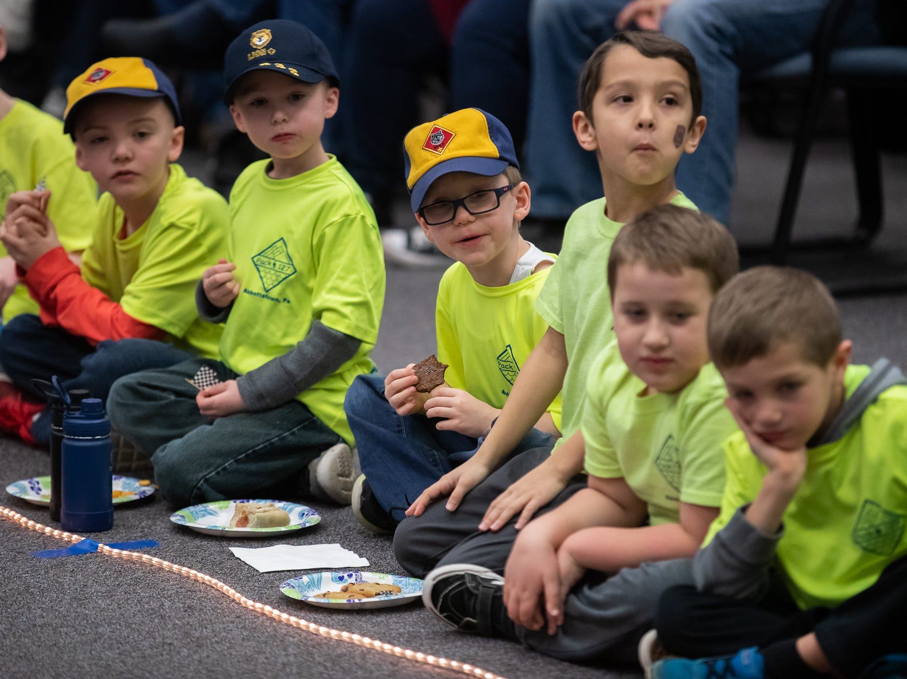 Cub scouts watch cars race during the cub scouts pack 127 Pinewood Derby event at Lincoln Intermediate Unit 12, Sunday, Feb. 10 in New Oxford. The scouts had a month to design their custom pinewood cars to race in the event.