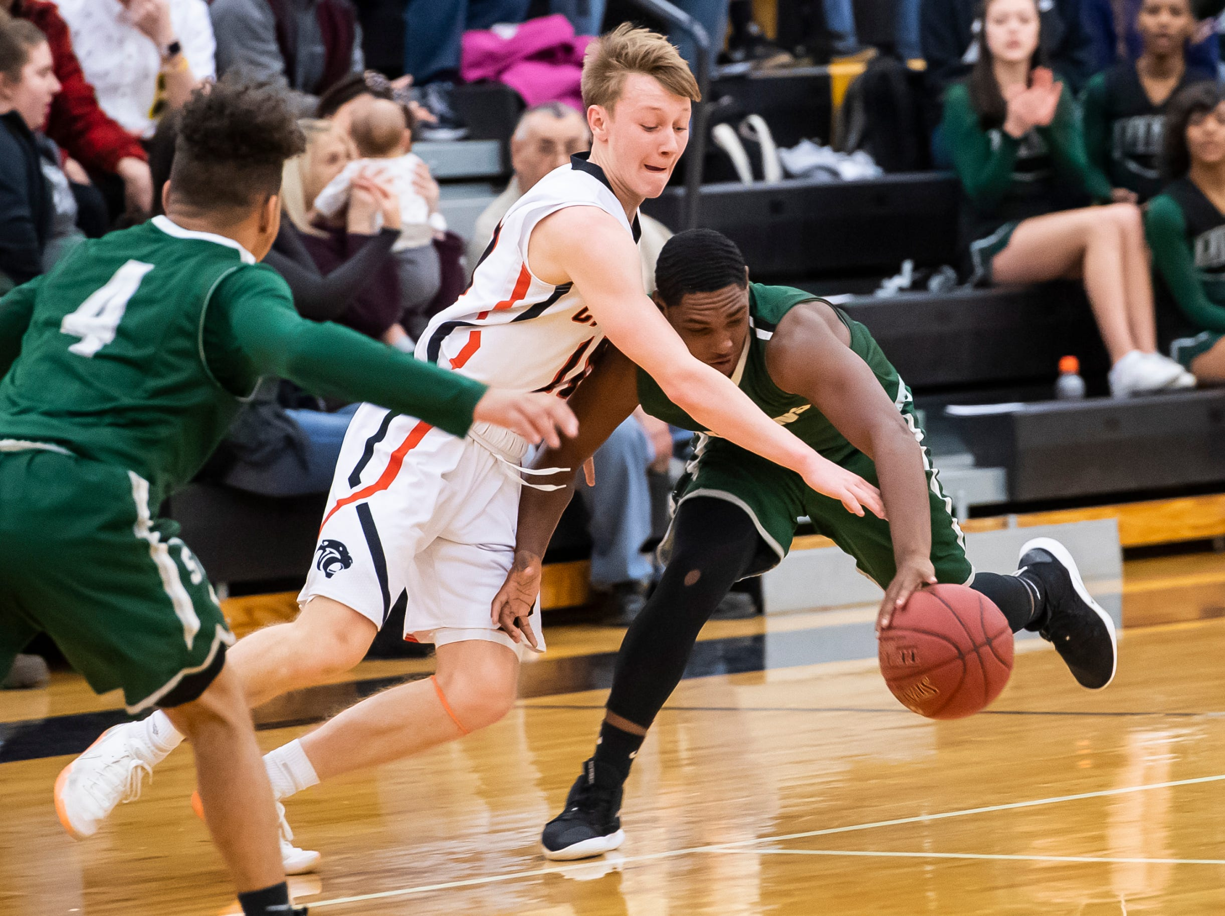 """Central York's Evan Eisenhart reaches for the ball as York County Tech's Jamal Jackson dribbles down the court in a YAIAA quarterfinal game at Red Lion High School Saturday, February 9, 2019. The Panthers won 74-43. Eisenhart led all players with 31 points. """"Every different night any different guy can bring it,"""" Central York head coach Kevin Schieler said. """"Tonight was Evan's night."""""""