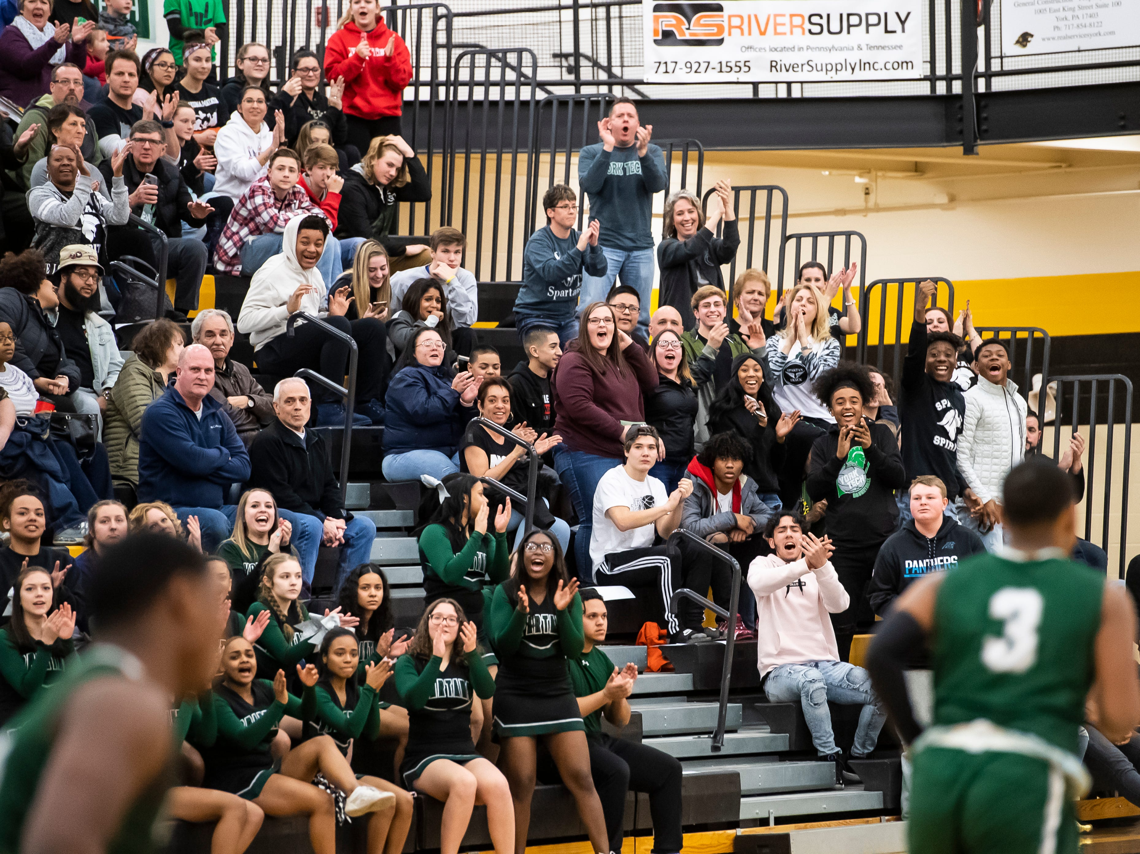 York County Tech fans react after the Spartans score during play against  Central York in a YAIAA quarterfinal game at Red Lion High School Saturday, February 9, 2019. The Panthers won 74-43.