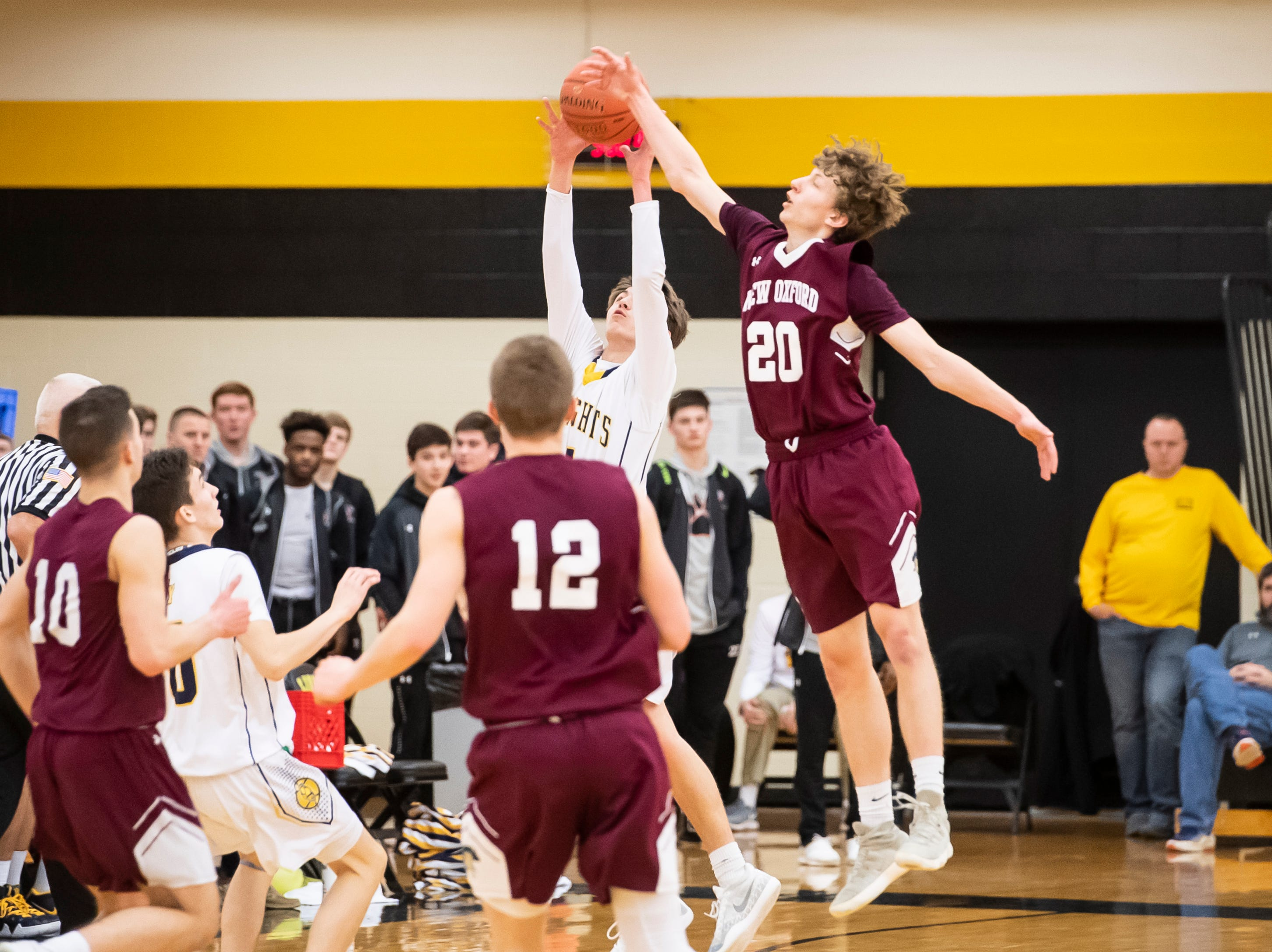 Eastern York's Trevor Seitz grabs a high pass late in the fourth quarter of play against New Oxford in a YAIAA quarterfinal game at Red Lion High School Saturday, February 9, 2019.