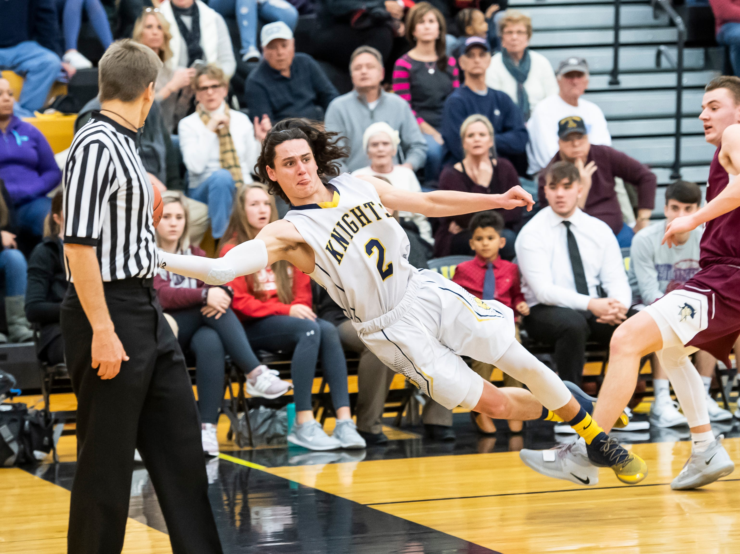"""Eastern York's Bryce Henise saves the ball from going out of bounds during play in a YAIAA quarterfinal game against New Oxford at Red Lion High School Saturday, February 9, 2019. """"If you are not ready, man, he'll punch you in the mouth before you realize it, metaphorically speaking,"""" New Oxford head coach Sean Bair said of Henise."""
