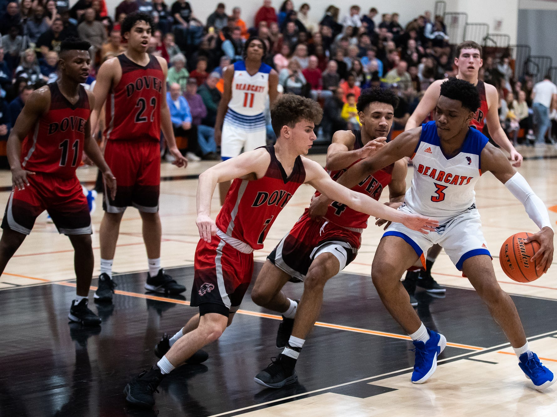 York High's Clovis Gallon Jr. (3) drives to the basket during the second half of a YAIAA quarterfinal between York High and Dover, Saturday, Feb. 9, 2019, at Central York High School. The York High Bearcats defeated the Dover Eagles 75-53.