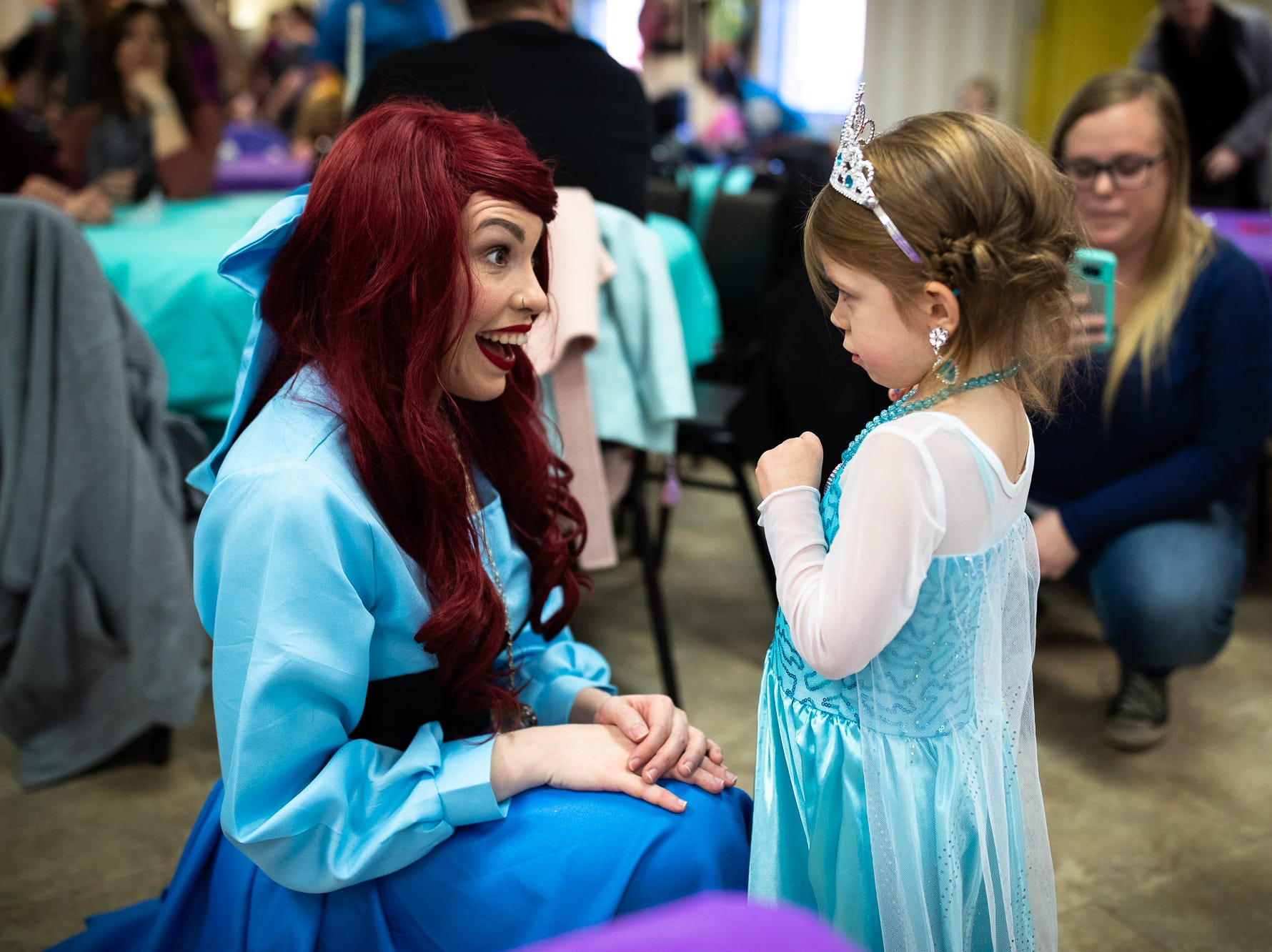 Princess Ariel greets kids in attendance at a princess teatime hosted by the Black Rose Rollers, Saturday, Feb. 9, 2019, at the Hanover YWCA.
