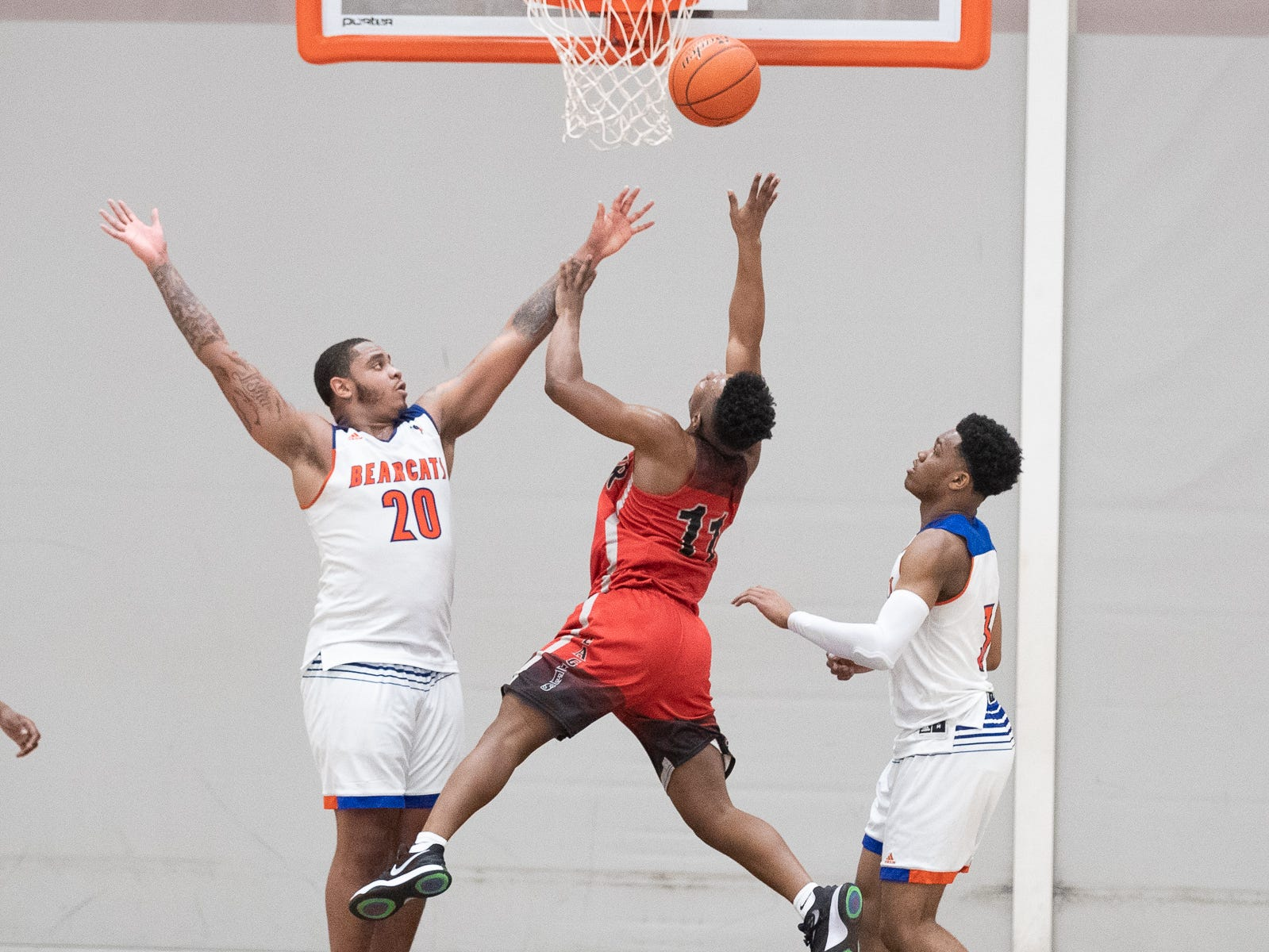 Dover's Victor Dorm (11)  shoots a layup during the second half of a YAIAA quarterfinal between York High and Dover, Saturday, Feb. 9, 2019, at Central York High School. The York High Bearcats defeated the Dover Eagles 75-53.