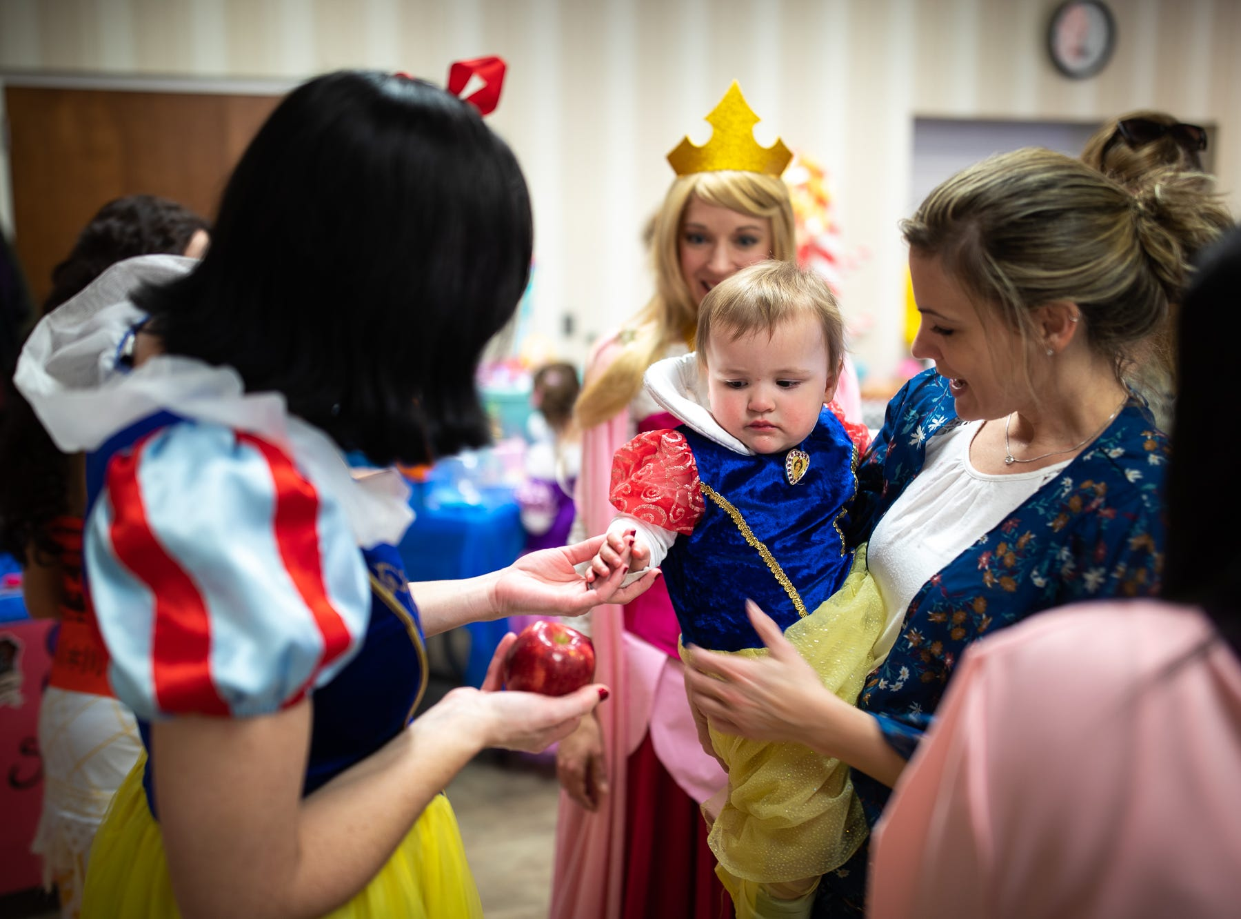 Princess Snow White speaks with Josie, almost 2, also dressed as Snow White, during a princess teatime hosted by the Black Rose Rollers, Saturday, Feb. 9, 2019, at the Hanover YWCA.