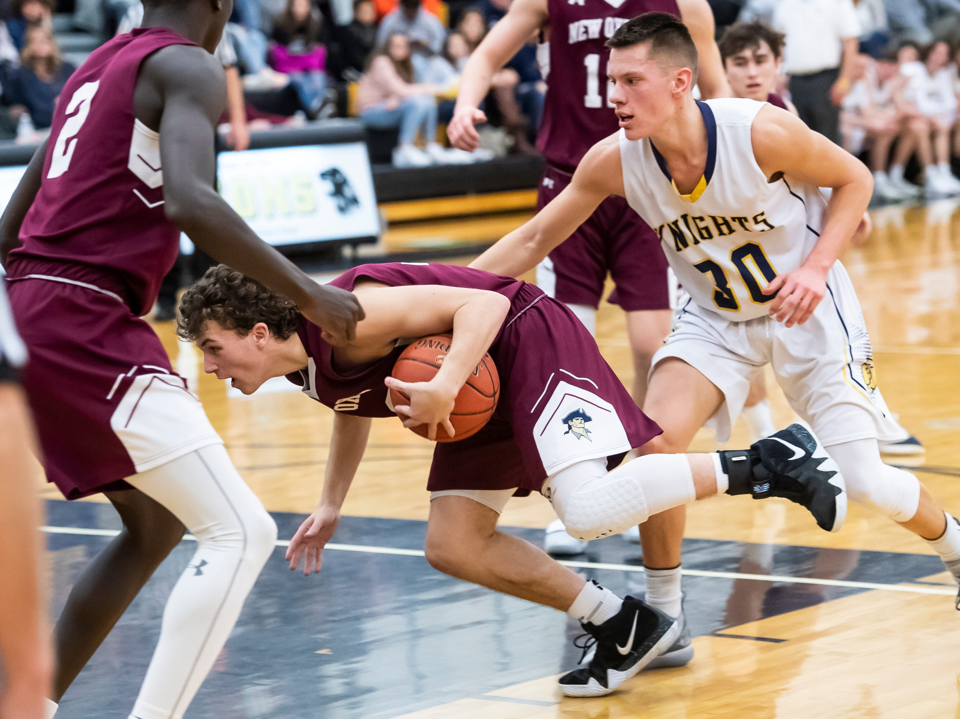 New Oxford's Connor Jenkins dives into the paint during play against Eastern York in a YAIAA quarterfinal game at Red Lion High School Saturday, February 9, 2019. The Colonials won 54-44.