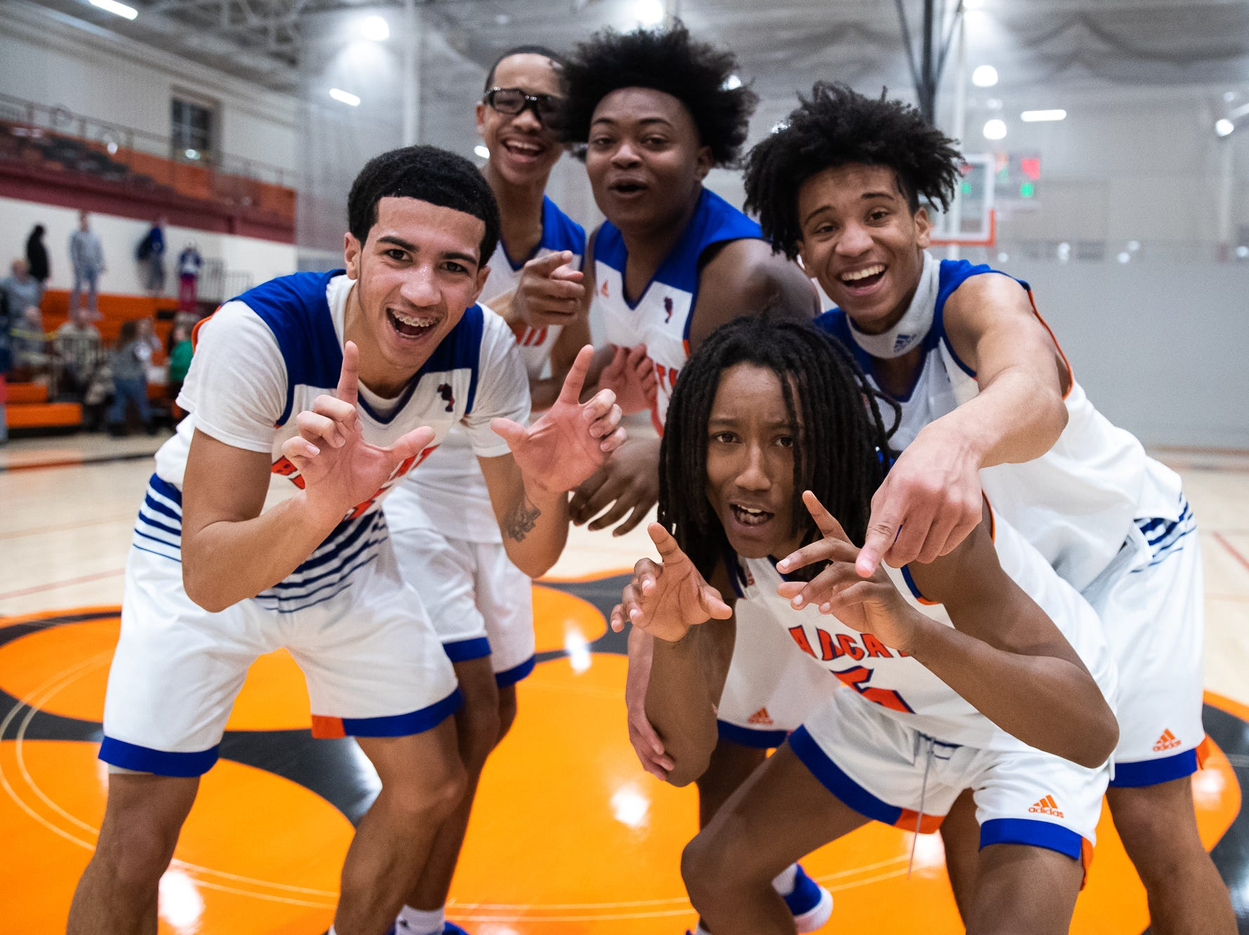 The York High Bearcats celebrate after winning their YAIAA quarterfinal against Dover, Saturday, Feb. 9, 2019, at Central York High School. The York High Bearcats defeated the Dover Eagles 75-53.