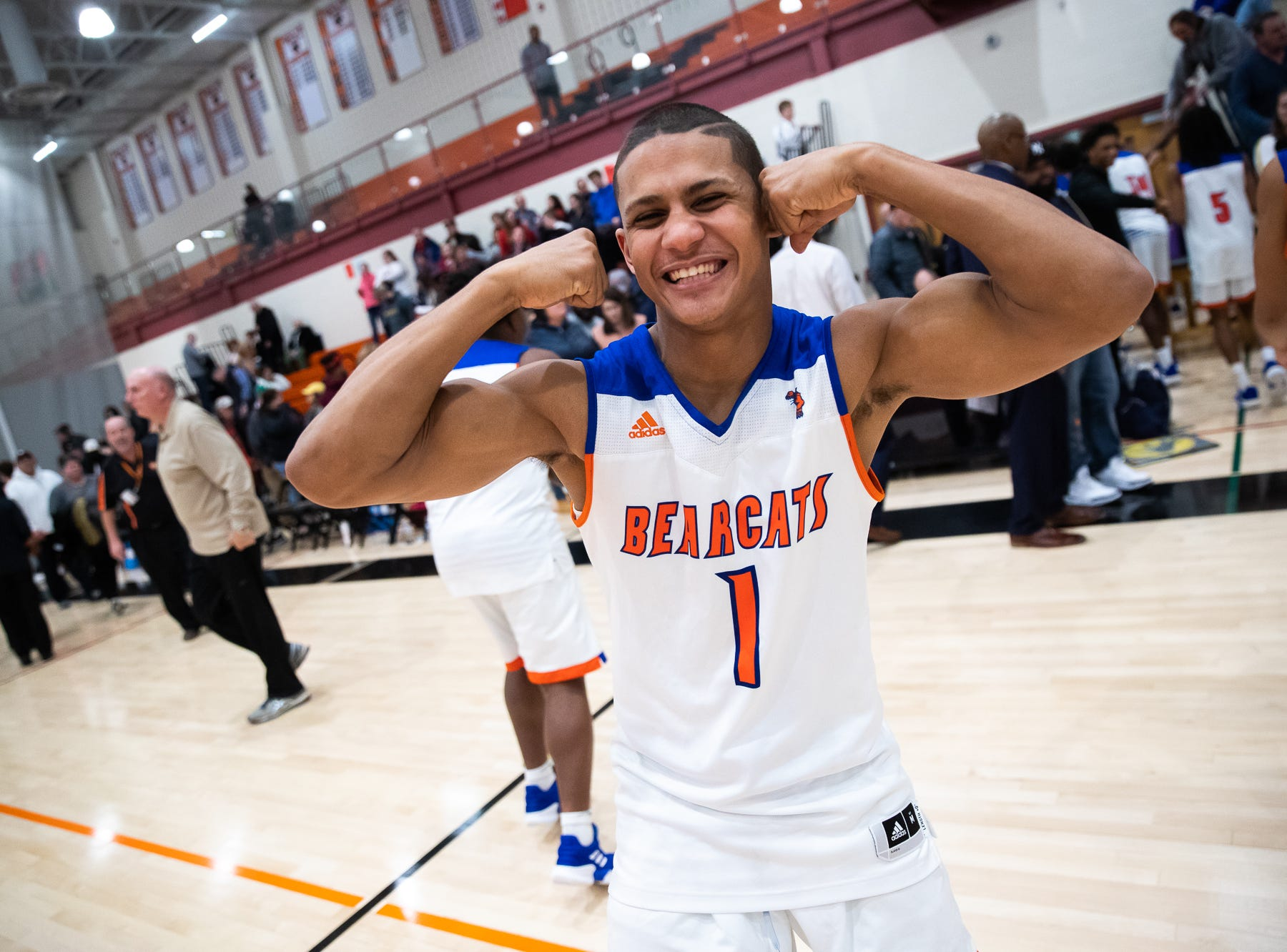 York High's Tobee Stokes (1) celebrates after winning his YAIAA quarterfinal against Dover, Saturday, Feb. 9, 2019, at Central York High School. The York High Bearcats defeated the Dover Eagles 75-53.