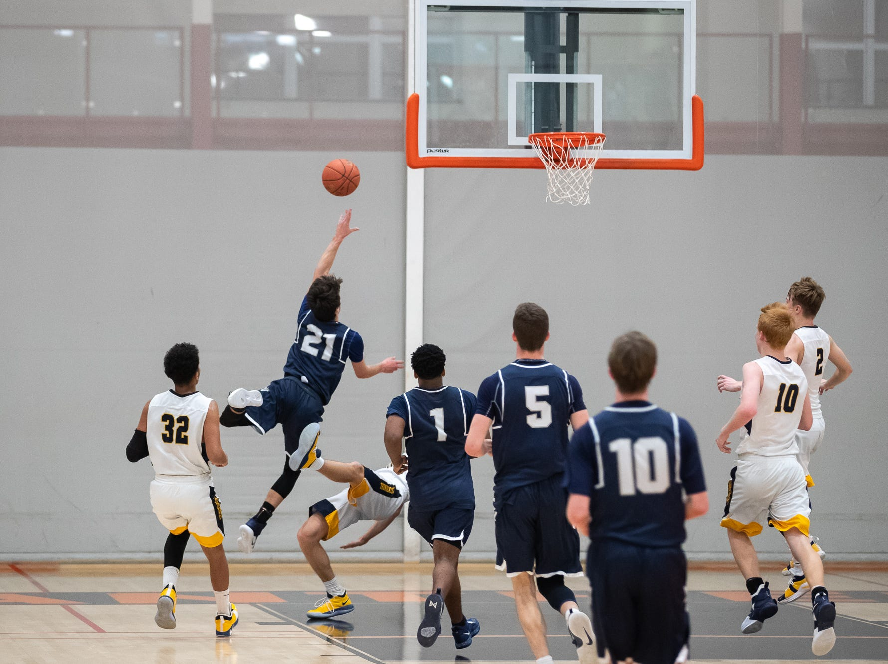 West York's Jared Shearer (21) shoots for a layup during the second half of the YAIAA boys' basketball quarterfinals between Littlestown and West York, Saturday, Feb. 9, 2019, at Central York High School. The Littlestown Bolts defeated the West York Bulldogs 73-63.