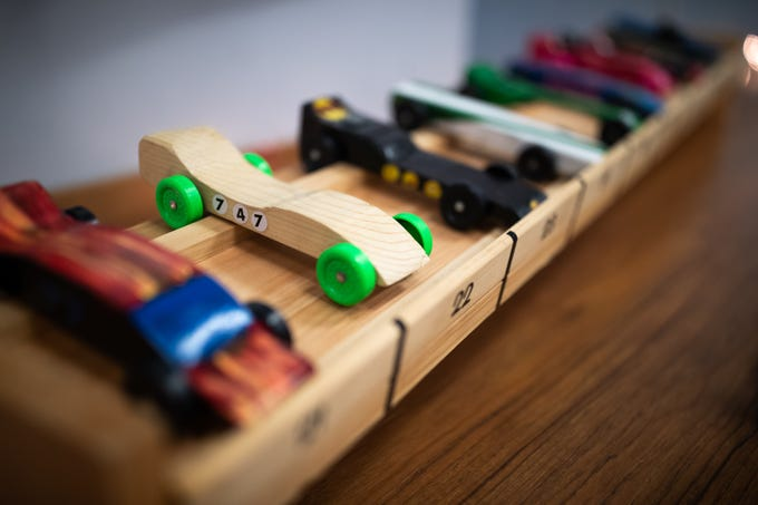 Pinewood cars sit in their numbered places during the cub scouts pack 127 Pinewood Derby event at Lincoln Intermediate Unit 12, Sunday, Feb. 10 in New Oxford. The scouts had a month to design their custom pinewood cars to race in the event.