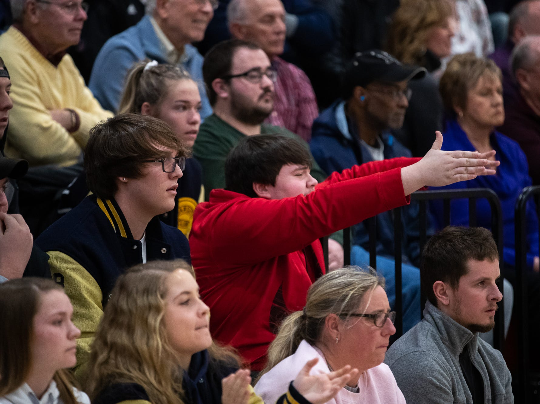 Fans react during the second half of the YAIAA boys' basketball quarterfinals between Littlestown and West York, Saturday, Feb. 9, 2019, at Central York High School. The Littlestown Bolts defeated the West York Bulldogs 73-63.