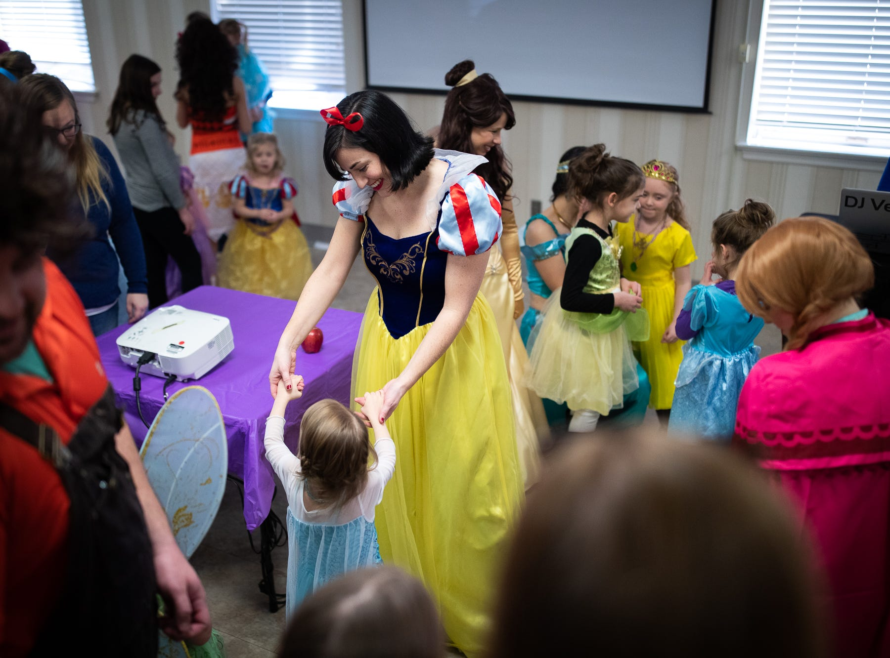Princess Snow White dances with kids during a princess teatime hosted by the Black Rose Rollers, Saturday, Feb. 9, 2019, at the Hanover YWCA.