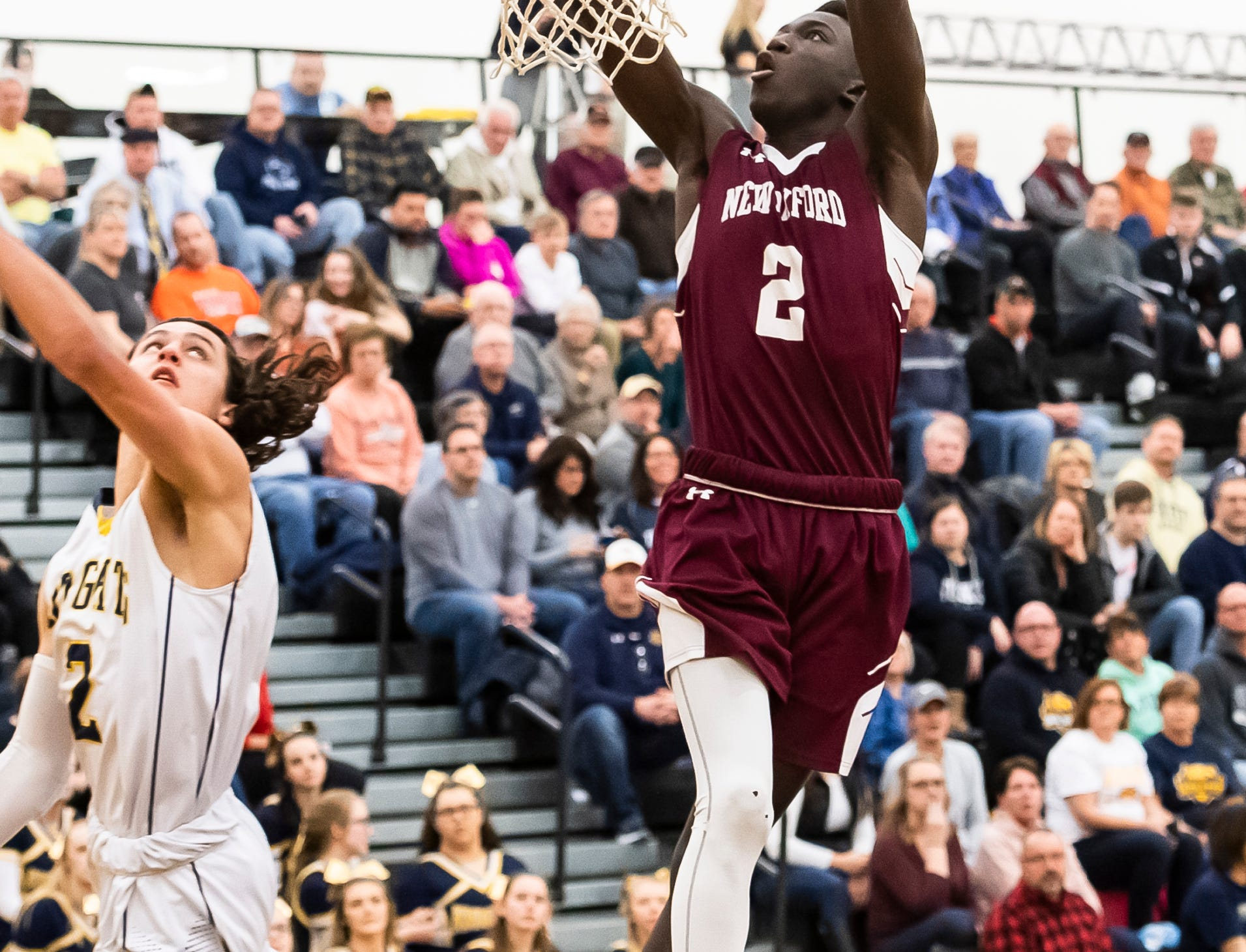 """New Oxford's Abdul Janneh dunks the ball during play against Eastern York in a YAIAA quarterfinal game at Red Lion High School Saturday, February 9, 2019. Janneh led all players with 20 points. """"How do you guard this guy?"""" New Oxford head coach Sean Bair said of Janneh. """"He's been very good the last month. I couldn't be more happy for him."""""""