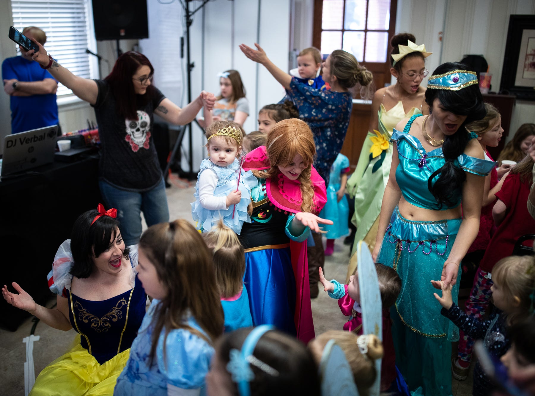 Princesses Snow White, Anna, and Jasmine sing along with kids during a princess teatime hosted by the Black Rose Rollers, Saturday, Feb. 9, 2019, at the Hanover YWCA.