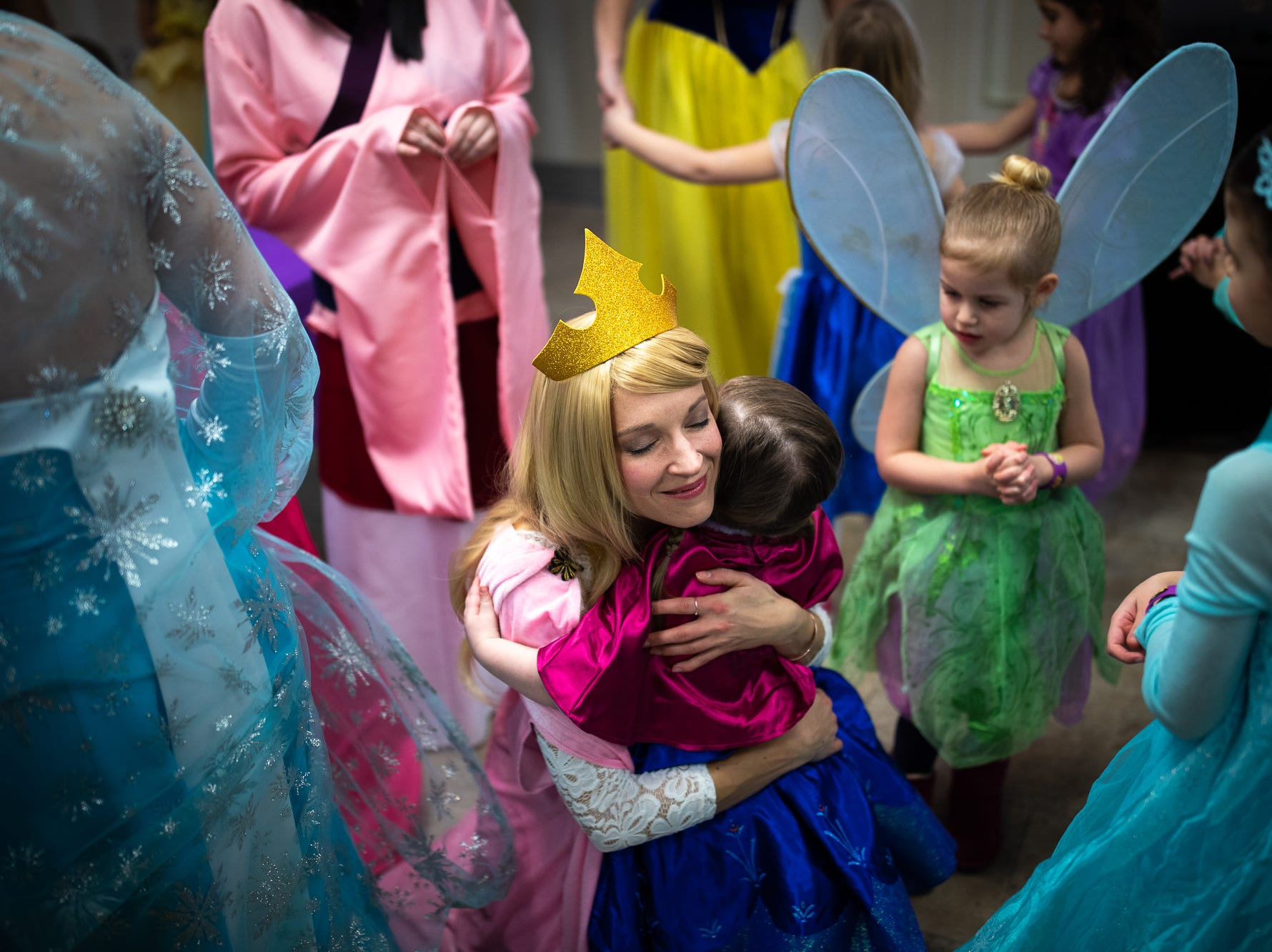 Princess Aurora, portrayed by Jill Rakowicz, embraces Cecilia Chesney, 2, during a princess teatime hosted by the Black Rose Rollers, Saturday, Feb. 9, 2019, at the Hanover YWCA.