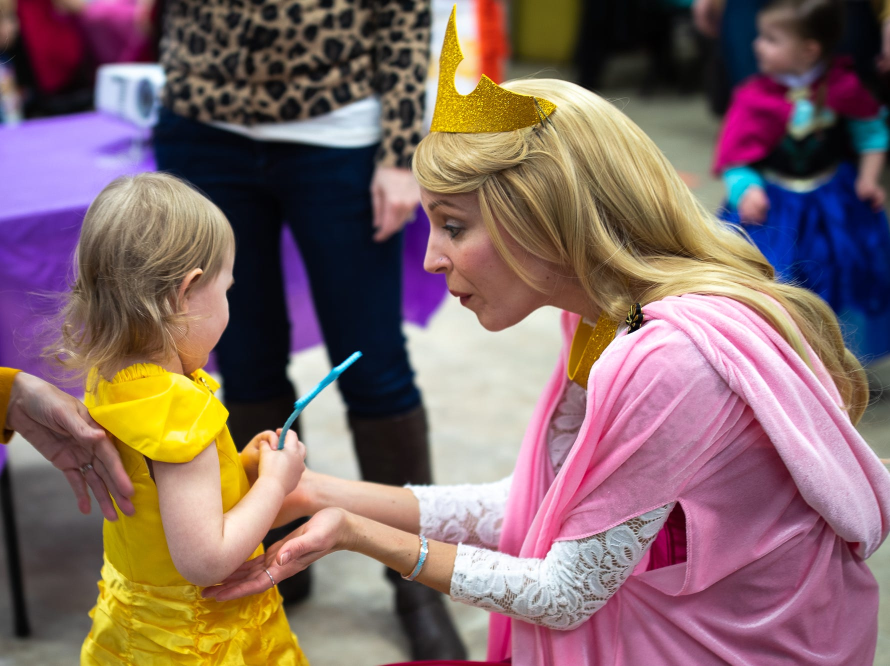 Lyla, 3, is greeted by Princess Aurora during a princess teatime hosted by the Black Rose Rollers, Saturday, Feb. 9, 2019, at the Hanover YWCA.